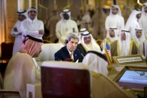 U.S. Secretary of State Kerry listens while Oman's Foreign Minister Yusuf speaks during a meeting of foreign ministers of the GCC in Doha