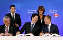 EU Commission President Juncker, Canada's PM Trudeau and EU Council President Tusk attend the signing ceremony of the CETA in Brussels